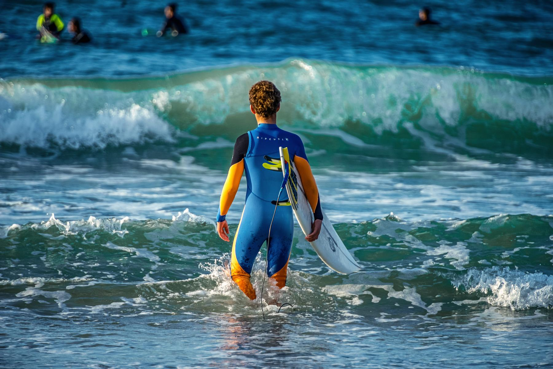 Surfer in a wetsuit at the beach