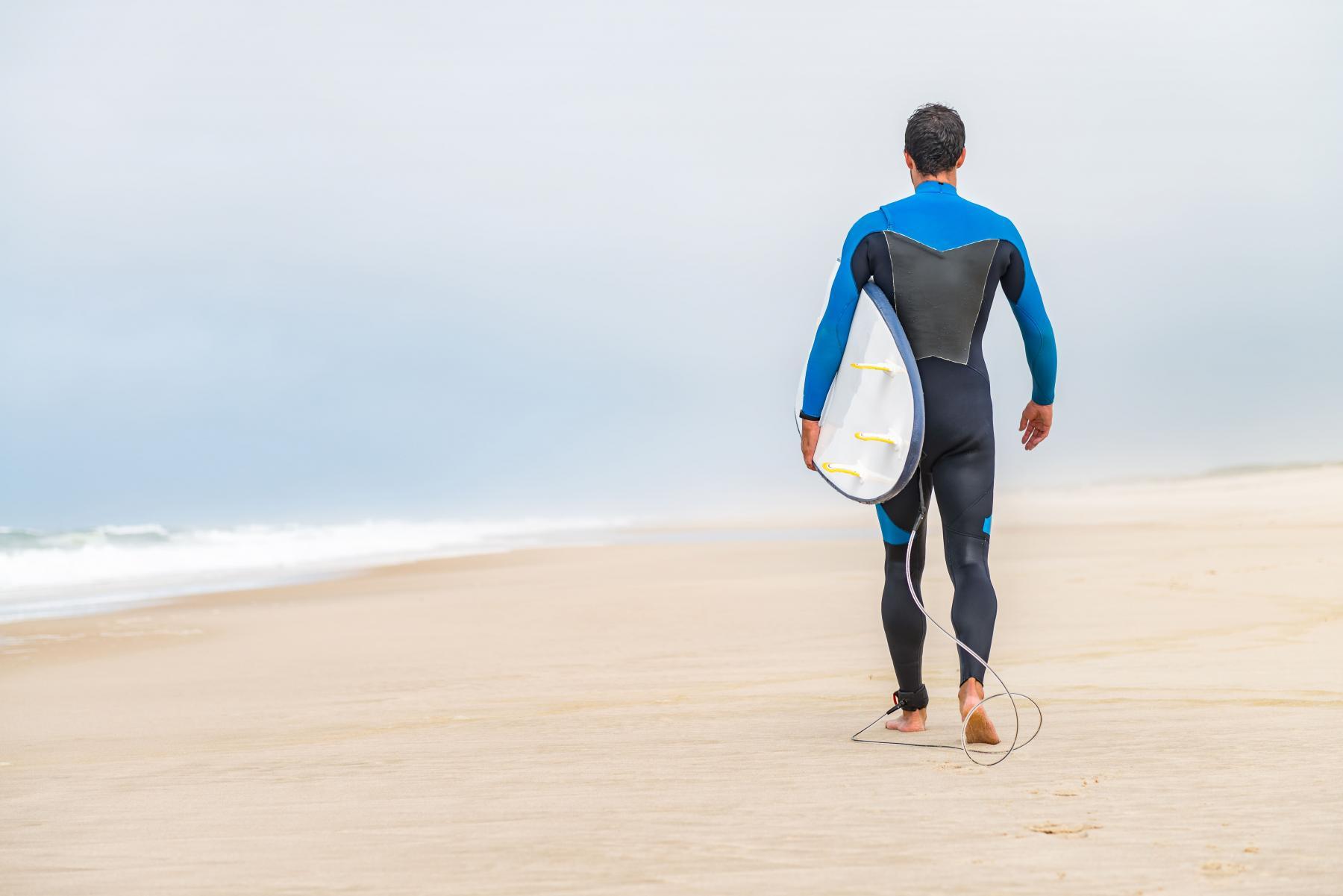 Man in a zipperless wetsuit