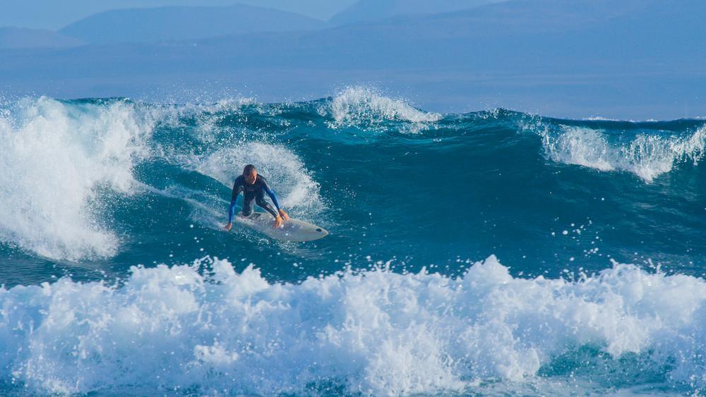 Rocky point surfer